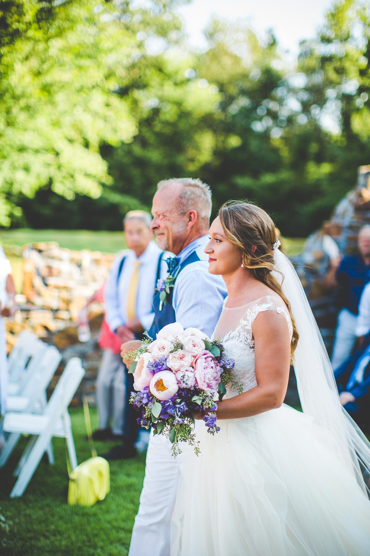 Wedding In July Bride Walks Down Aisle At Safras Springs Vineyard